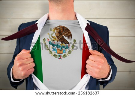 Businessman opening shirt to reveal mexico flag against bleached wooden planks background