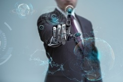 businessman operating virtual hud interface and manipulating elements with robotic hand. Blue holographic screen artificial design concept.
