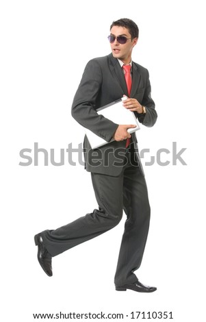 Businessman or hacker in sun glasses with laptop running, isolated