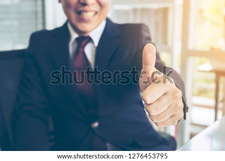 Businessman or Insurance agent or Honest Lawyer Partner Professional make Law Business Agreement Complete Deal showing thumbs up with copy space. Respect Customer Partnership Trust Promise Concept.