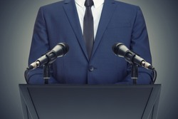 Businessman or politician making speech from behind the pulpit