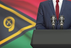 Businessman or politician making speech from behind the pulpit with national flag on background - Vanuatu