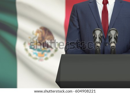 Shutterstock Businessman or politician making speech from behind the pulpit with national flag on background - Mexico