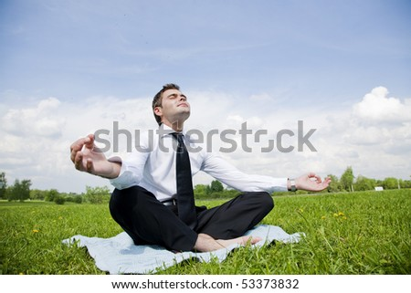 businessman outdoor do yoga exercise