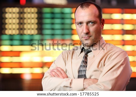 Businessman over stock exchange background