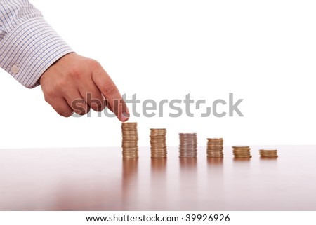 businessman picking a coin in pile of money