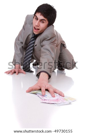 Businessman picking money on the floor over white background selective focus