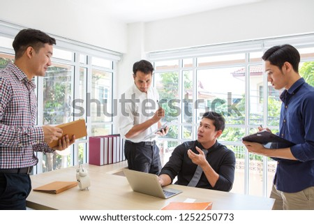 Businessman plaining data at meeting room. Business people meeting around desk. Asian people. Young business man. Asian people. #1252250773