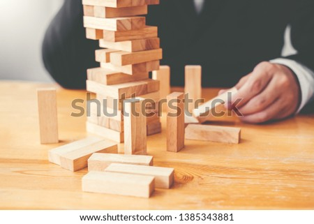 Businessman plan and strategy in business Domino Effect Problem Solving #1385343881