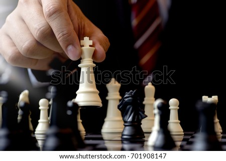Stock Photo Businessman play chess use King Chess Piece white to crash overthrow the competitor concept business strategy for win