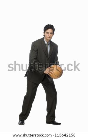 Businessman playing basket ball