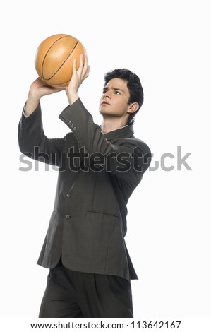 Businessman playing basket ball