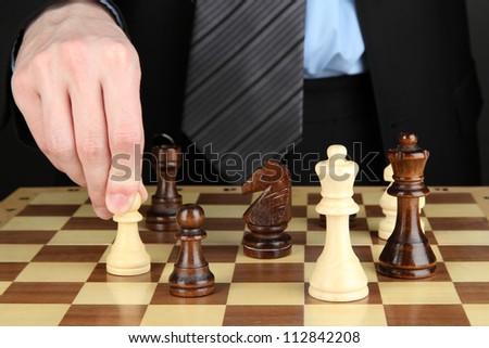 businessman playing chess close-up