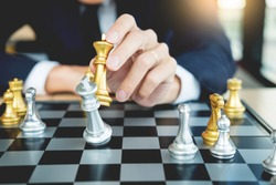 businessman playing  chess figure take a checkmate another king with team, strategy or management win or success concept