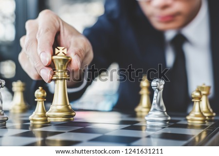 Businessman playing chess game reaching to plan strategy for success, thinking for planning overcoming difficulty and achieving goals business strategy for win, management or leadership concept. #1241631211