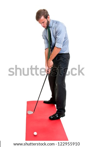 Businessman playing golf club isolated