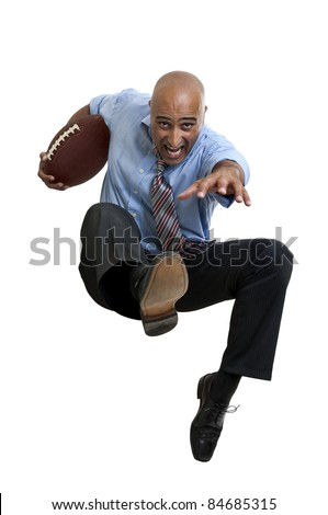 Businessman playing rugby isolated in white