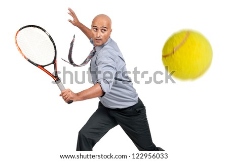 Businessman playing tennis isolated in white