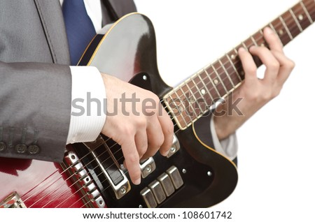 Businessman playing the guitar on white
