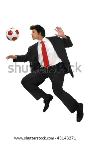Businessman playing with a soccer ball  isolated in white - stock photo