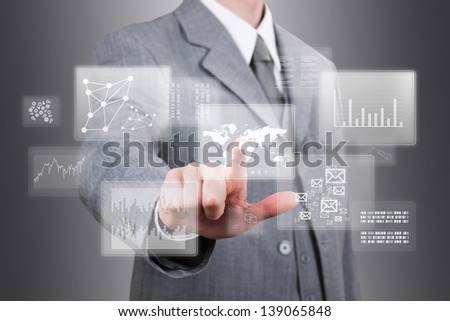 businessman point finger at a touch screen