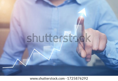 Businessman pointing arrow graph growing corporate. Development  to success and growing growth concept.   Start-up