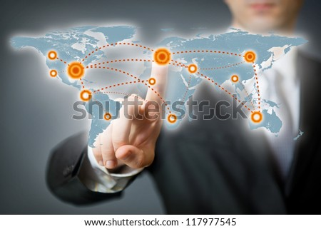 Businessman pointing at a spot on a world map