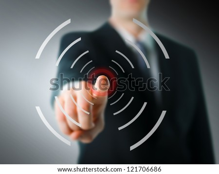 Businessman pointing at camera with digital elements