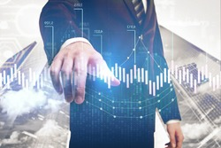 Businessman pointing at creative forex chart on abstract city background. Investment and management concept. Double exposure