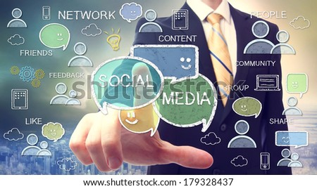 Businessman pointing at social media texts and cartoon