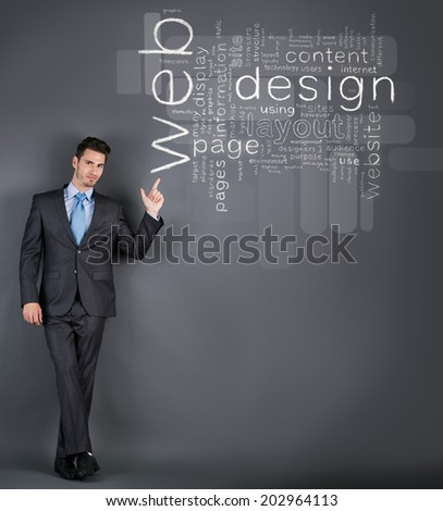 businessman pointing at web design words