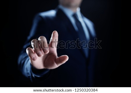 Businessman pointing finger on space for text. #1250320384