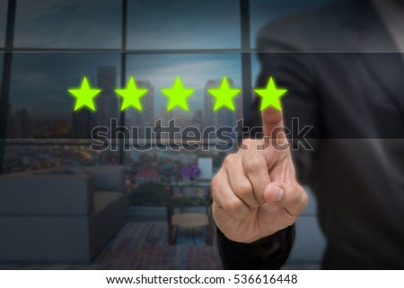 Businessman pointing five star symbol to increase rating of company or hotel over blurred of interior lobby background, business evaluation concept, Increase rating #536616448