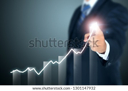 businessman pointing graph of success #1301147932