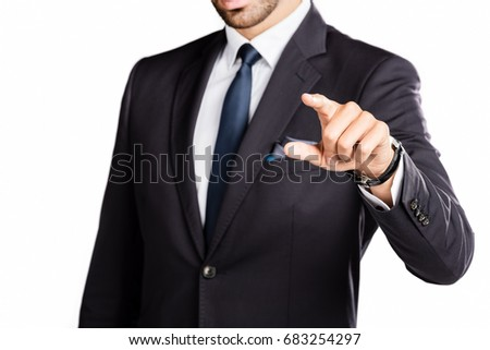 Businessman pointing his finger, wearing a suit and tie. Work and career concept.
