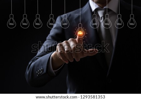 Businessman pointing light bulb