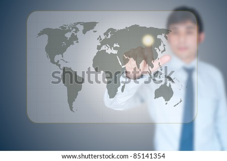 Businessman pointing on world map