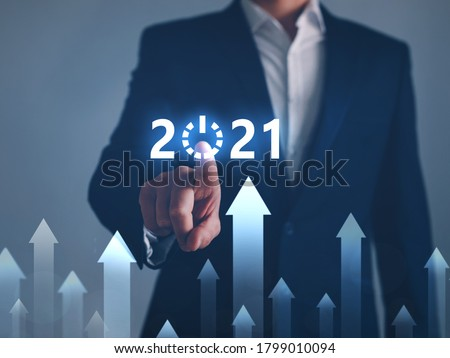 Businessman pointing START future button of year 2021. Development to success and growth concept.