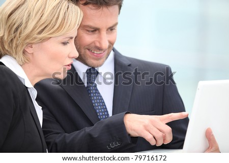 Businessman pointing to laptop screen