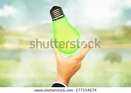 Businessman pointing with his finger against grey abstract light spot design