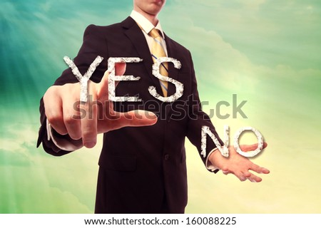 Businessman pointing YES over turquoise yellow colored sky background