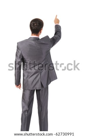 Businessman points finger up. Isolated on white