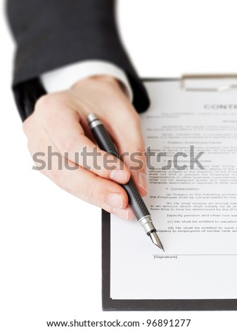 Businessman points on signature line on contract