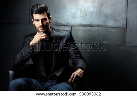 Shutterstock Businessman Portrait. Confident serious businessman sitting in armchair, looking at camera.