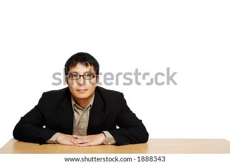 Businessman posing in an office, with copy space