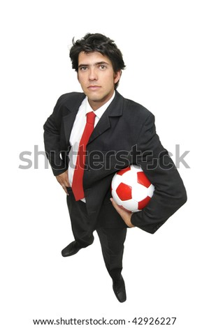 Businessman posing with a soccer ball isolated in white