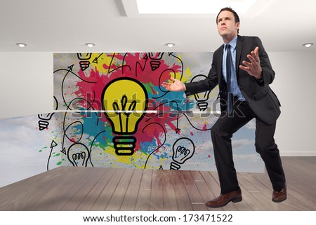 Businessman posing with arms outstretched against digitally generated room with stairs