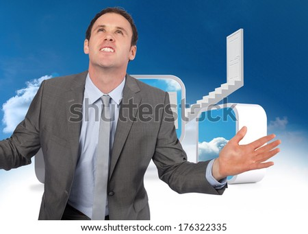 Businessman posing with hands out against steps leading to closed door in the sky