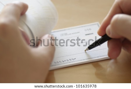 Businessman prepare writing check in the office