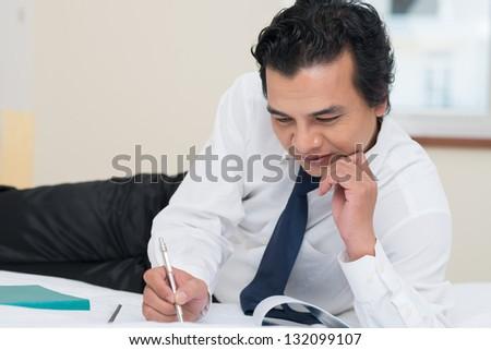 Businessman preparing for a seminar in a hotel room